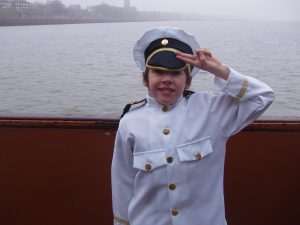 Captain David saluting on the boat.