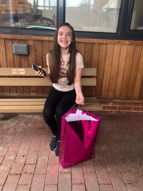 Big smiles from a birthday girl for her birthday bag B Bag